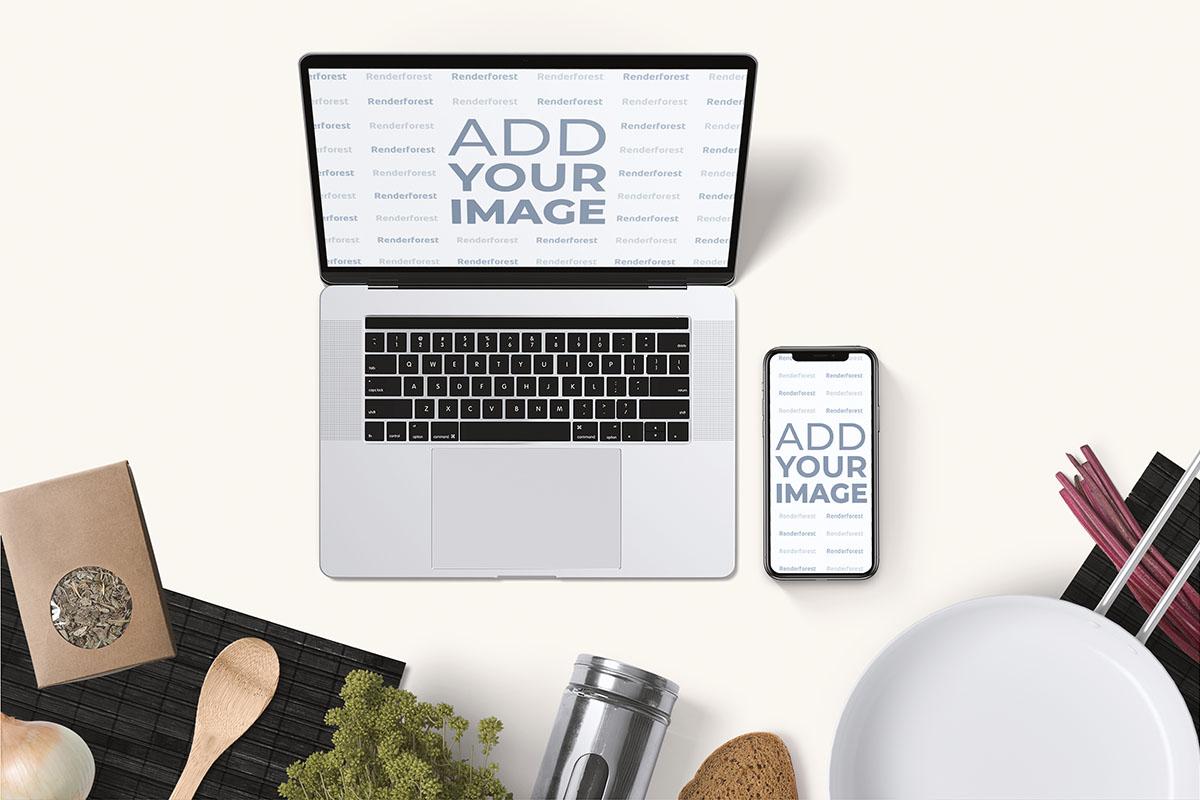 料理の背景にノート・パソコンとアイフォン
