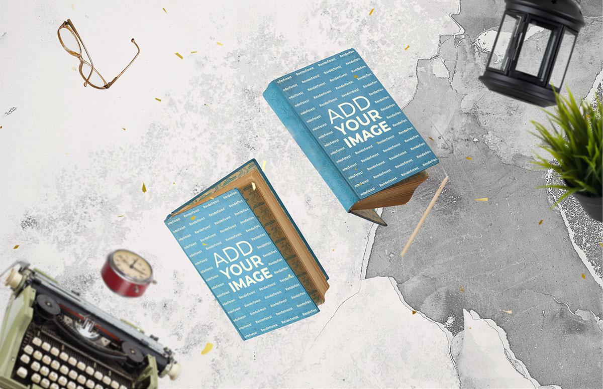 飛翔のハードカバーの古い本と骨董品