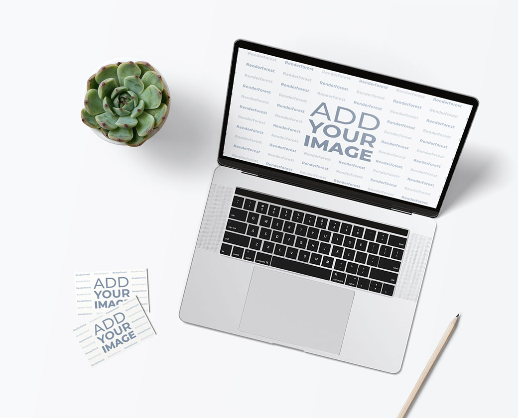 Workspace with a Laptop and Business Cards
