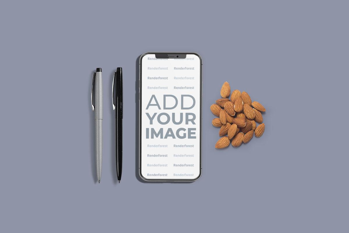iPhone com Canetas e Amêndoas