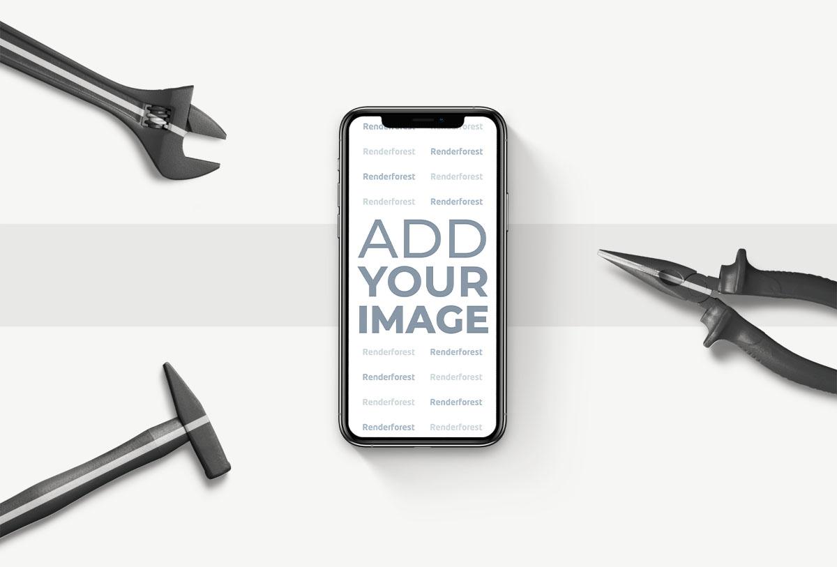 iPhone vertical junto a herramientas de reparación