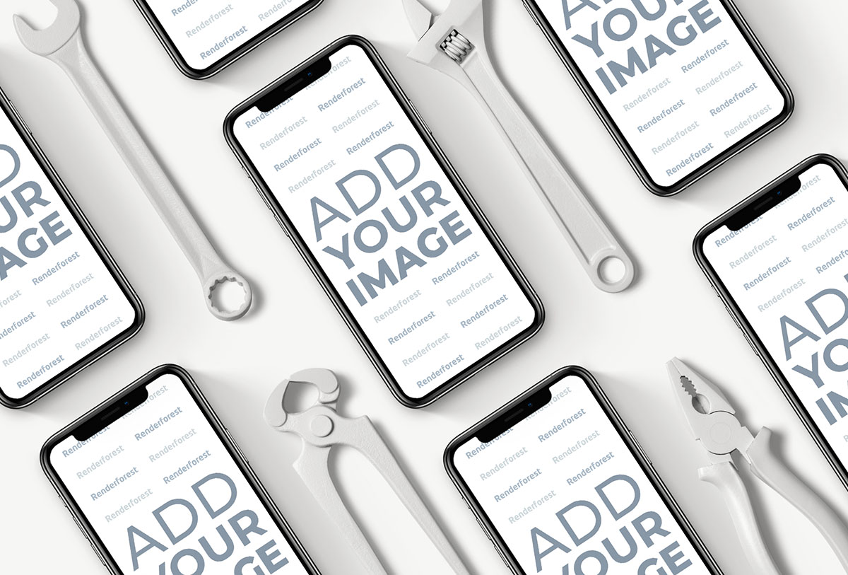 Múltiples iPhones junto a herramientas de reparación