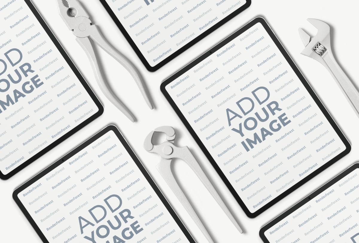 Múltiples iPad Pros junto a herramientas de reparación