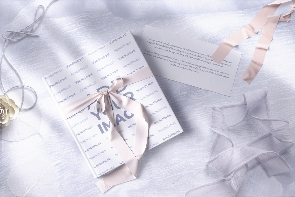 Album with a Ribbon and an Invitation Card