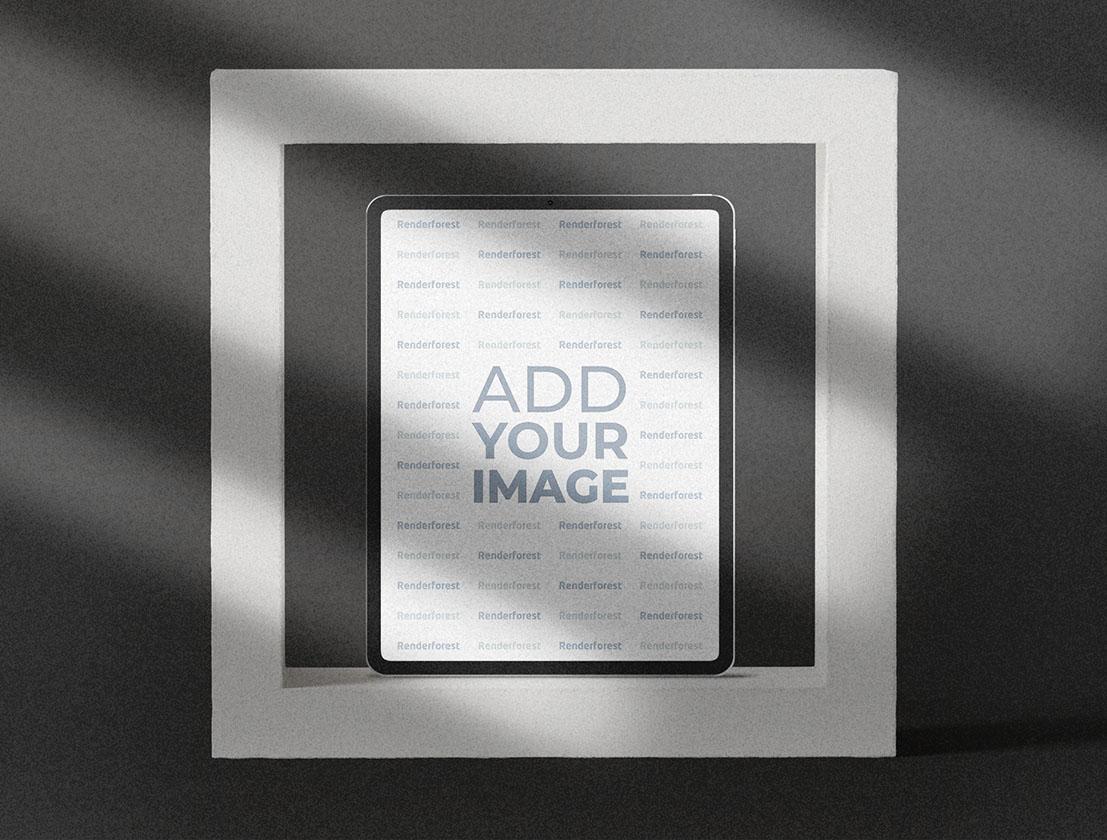 iPad auf einem grauen strukturierten Hintergrund
