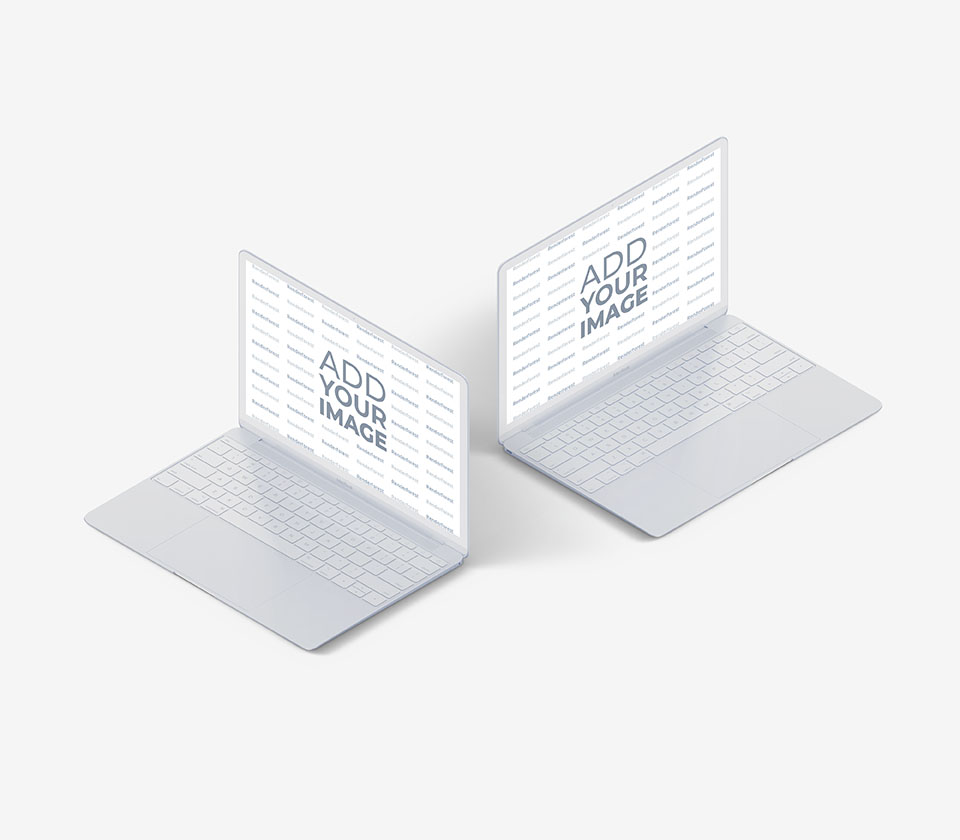 Two White MacBooks on a Gray Background