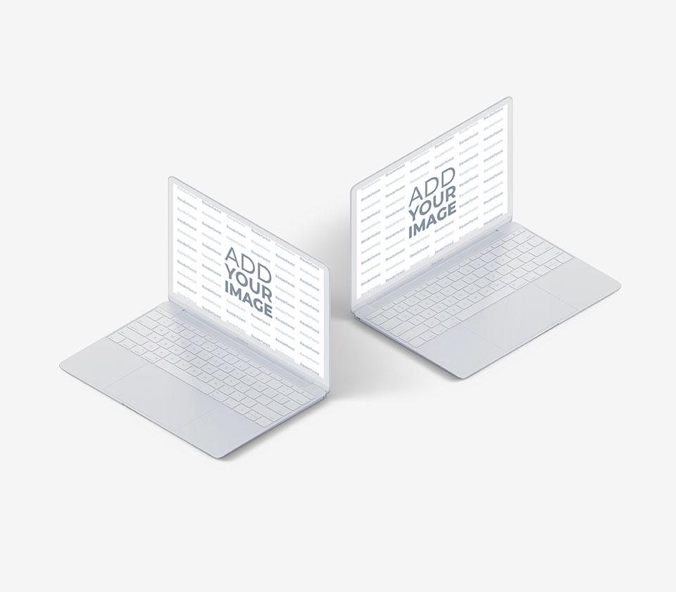 Dos MacBooks blancos sobre un fondo gris