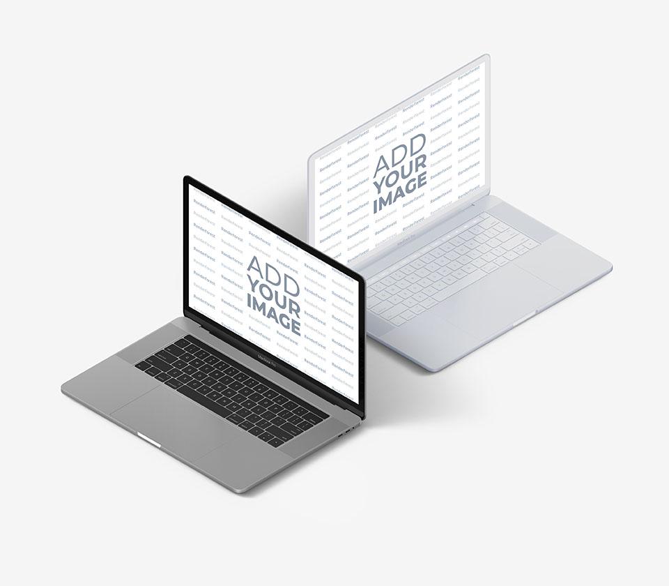 Dos MacBooks, uno blanco y otro gris