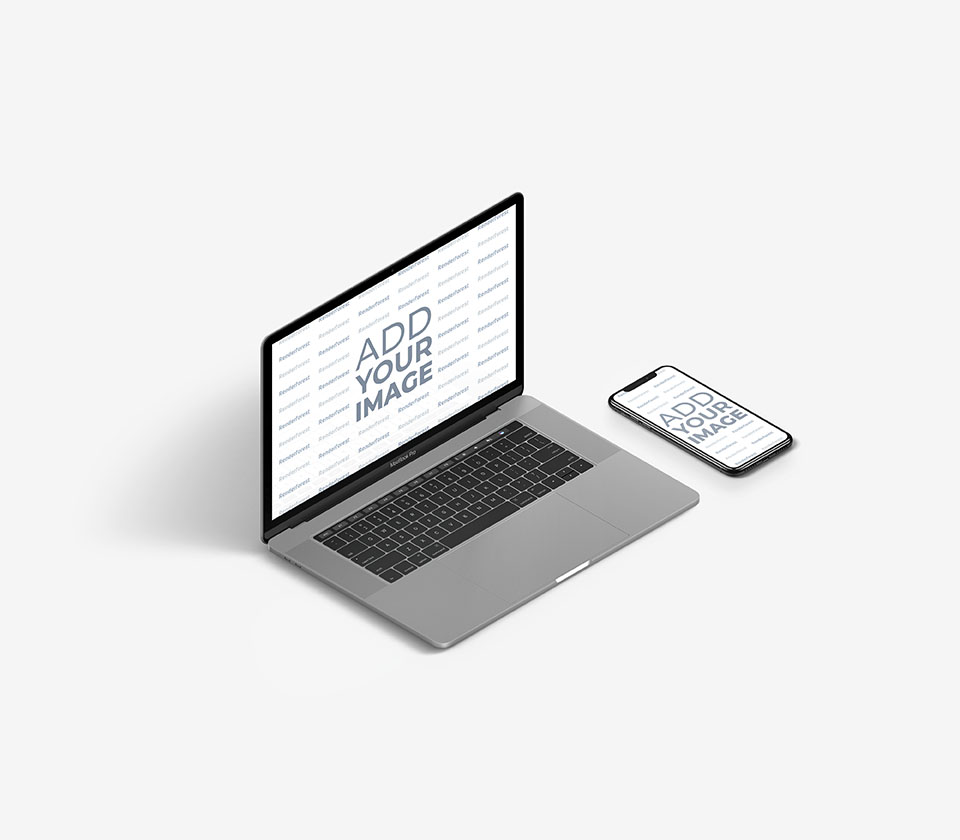 MacBook gris junto a un iPhone