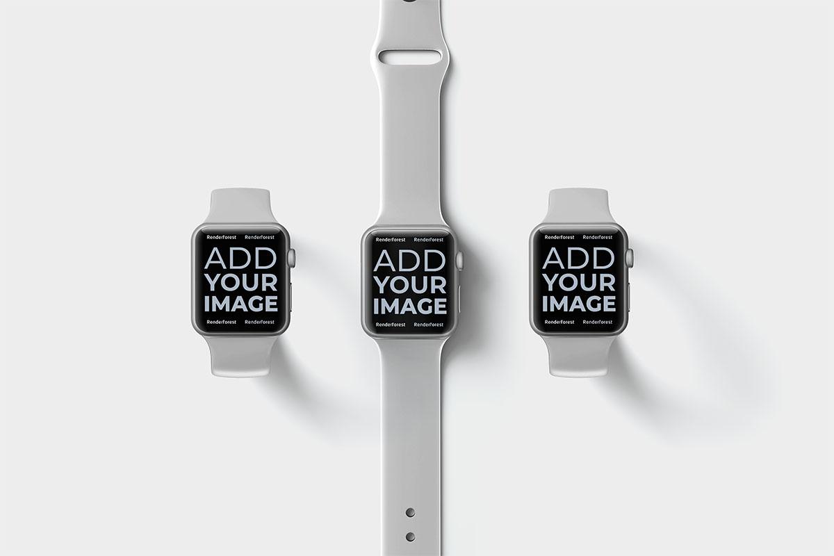 Trois Apple Watches sur une surface beige