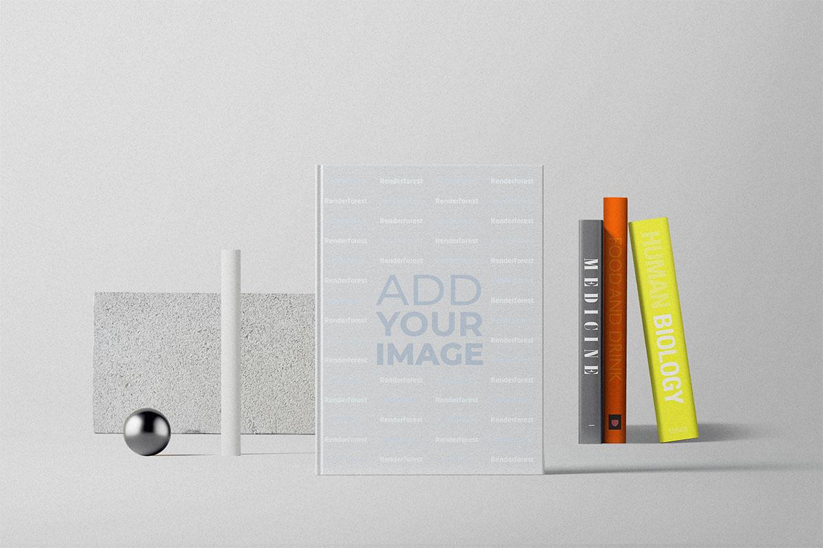 Livre à couverture rigide placé devant la collection de livres