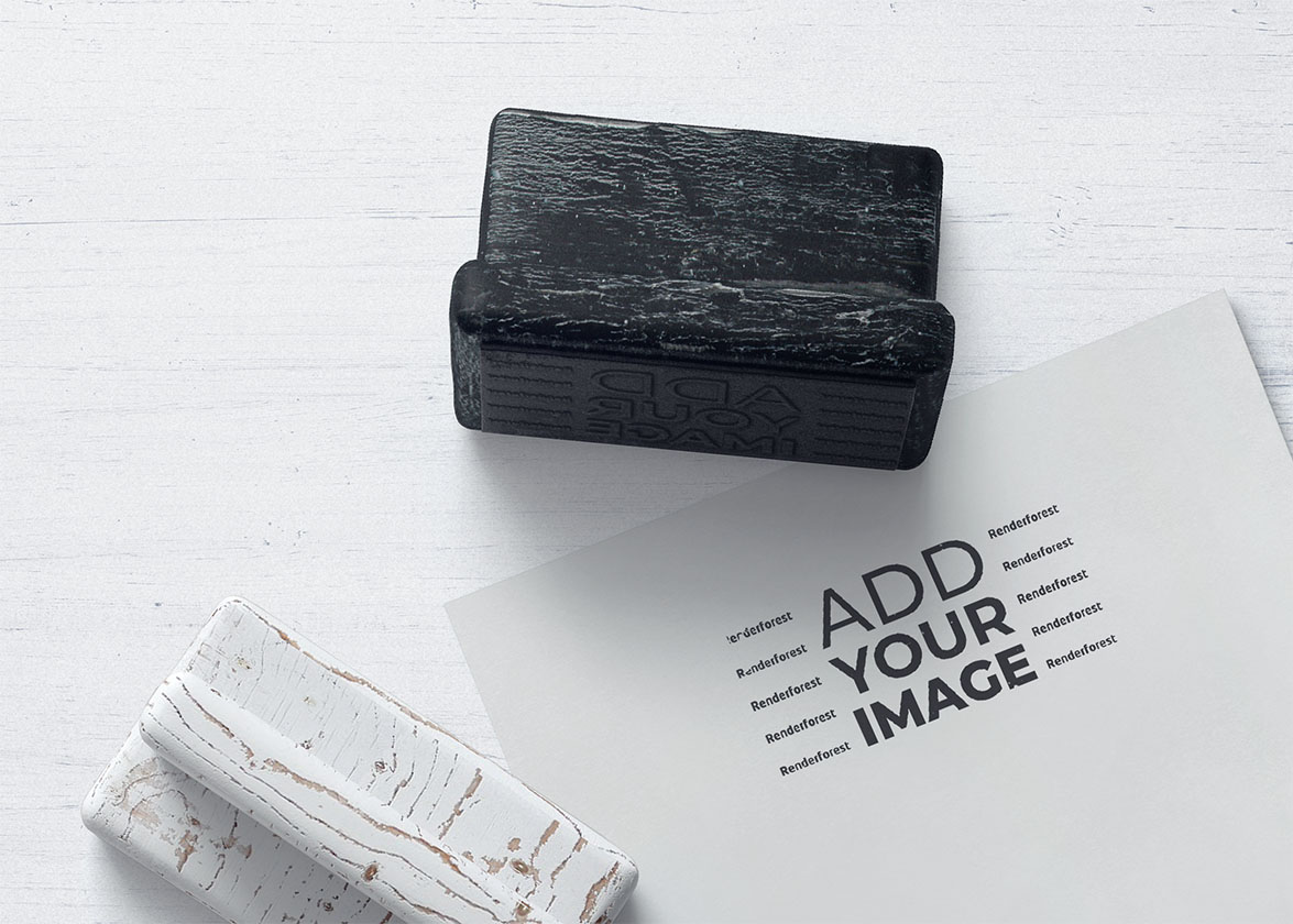 Two Wooden Stamps with a Business Flyer