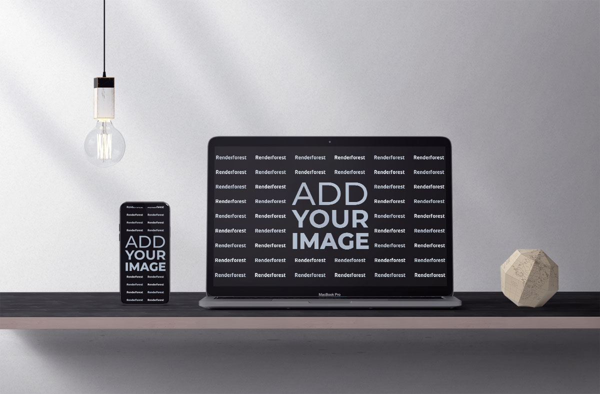現代の机の上にアイフォーンとマックブック