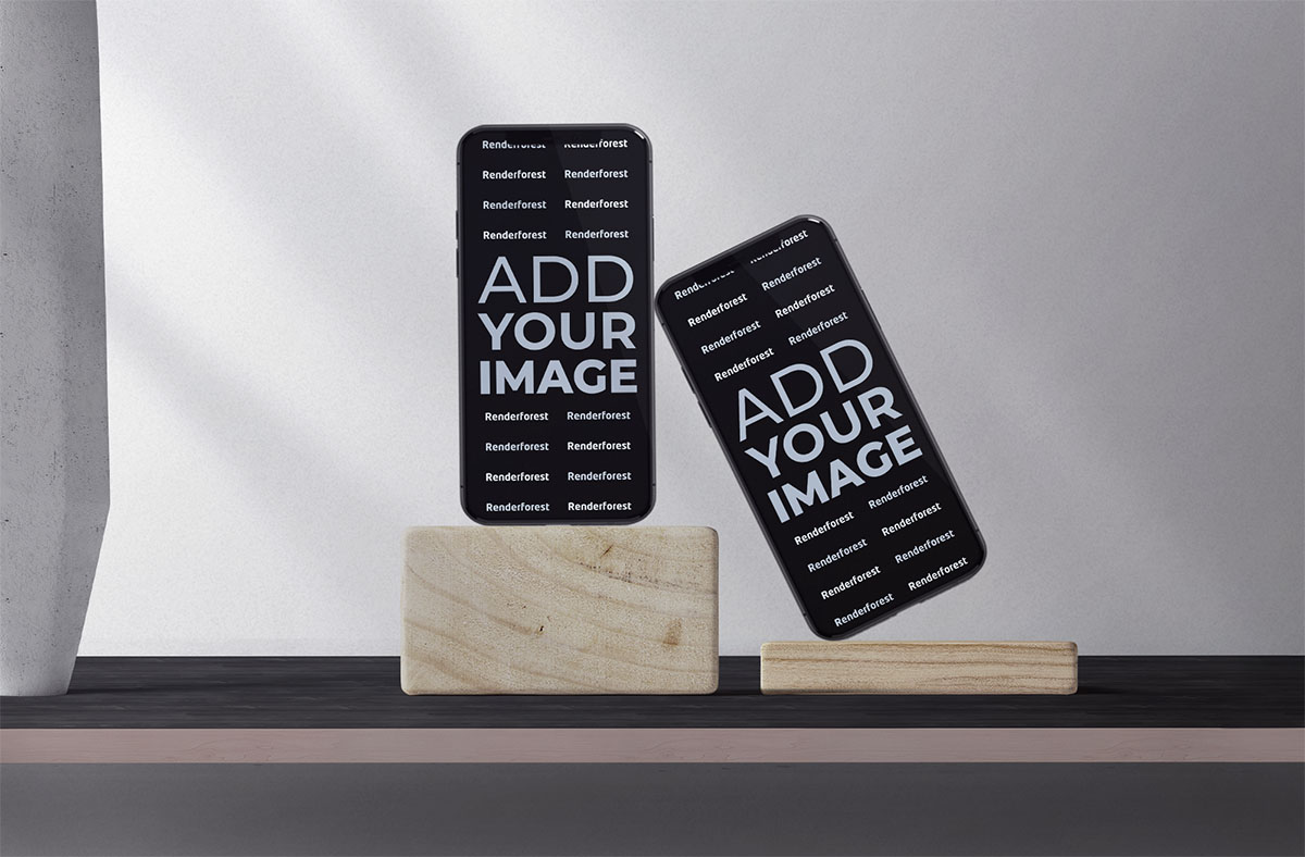 Two iPhones on Wooden Stands of a Desk