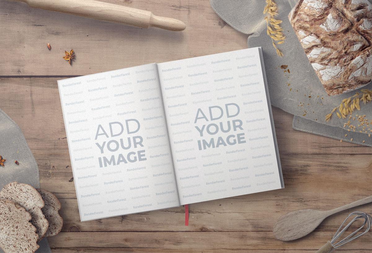 Aufgeschlagenes Back-Kochbuch mit einem Nudelholz