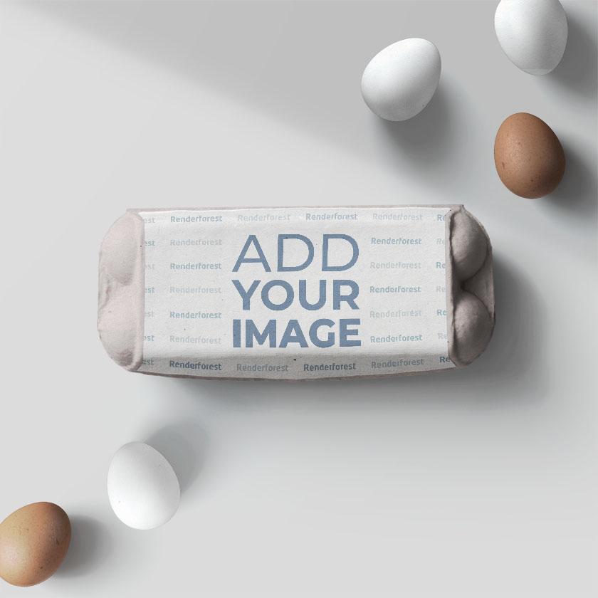 Caixa de Ovo de Papelão com Ovos ao Lado