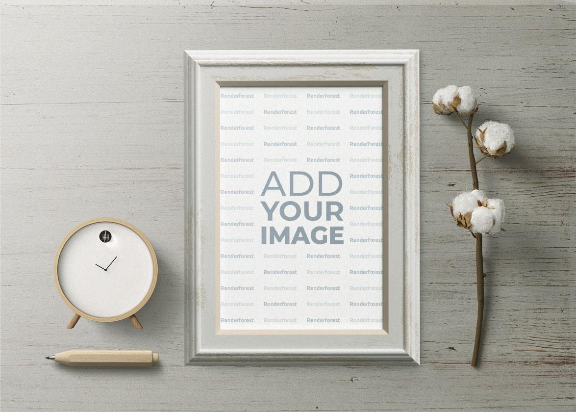 Cadre blanc avec une horloge et une branche de coton