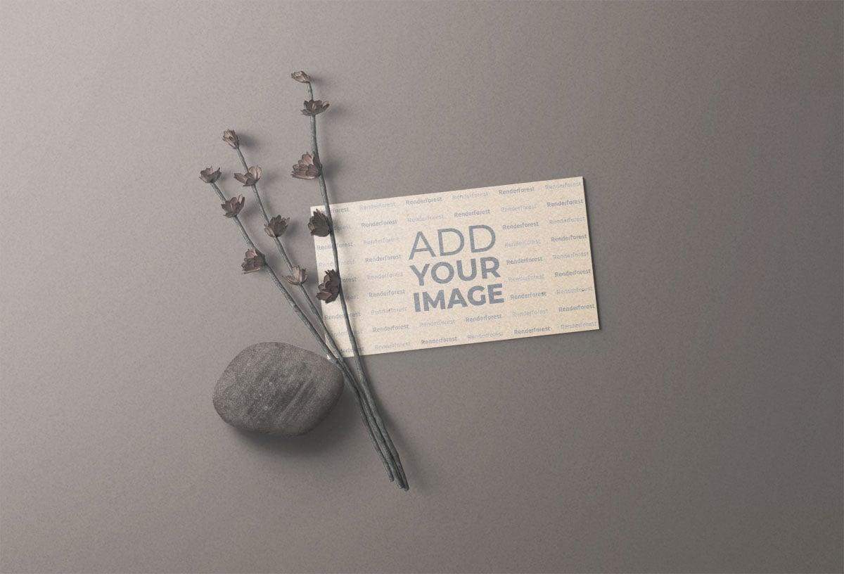 بطاقة عمل مع الحجر والنباتات الجافة