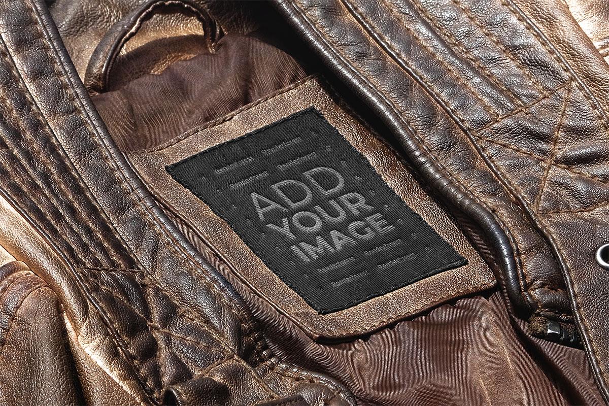 摩耗した革のコートのタグ