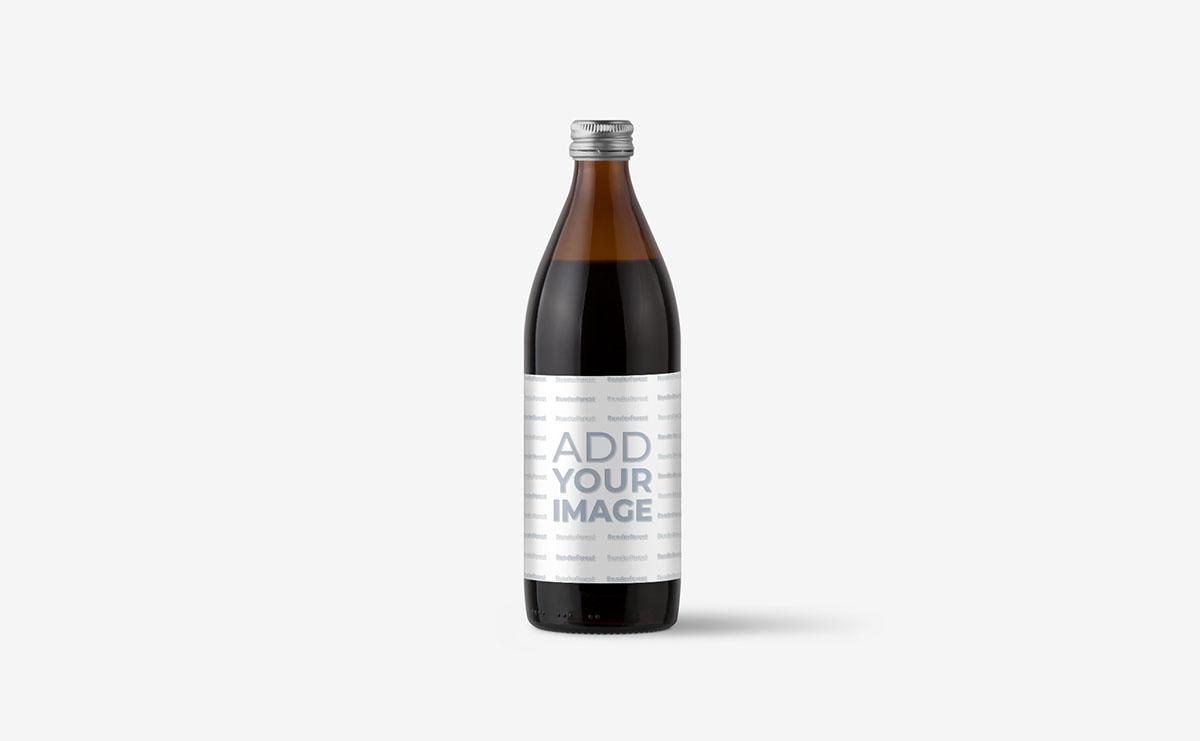 Une seule bouteille en verre sur une surface beige