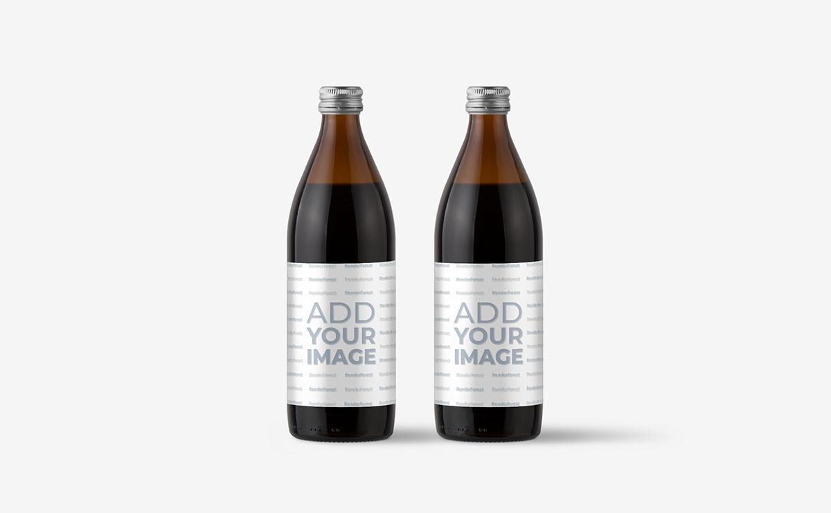 Deux bouteilles en verre sur une surface beige