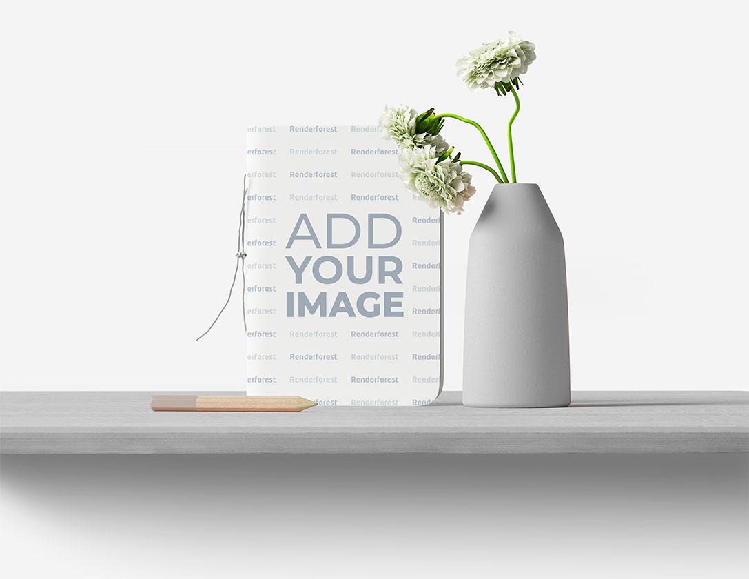 Блокнот, цветочная ваза и карандаш