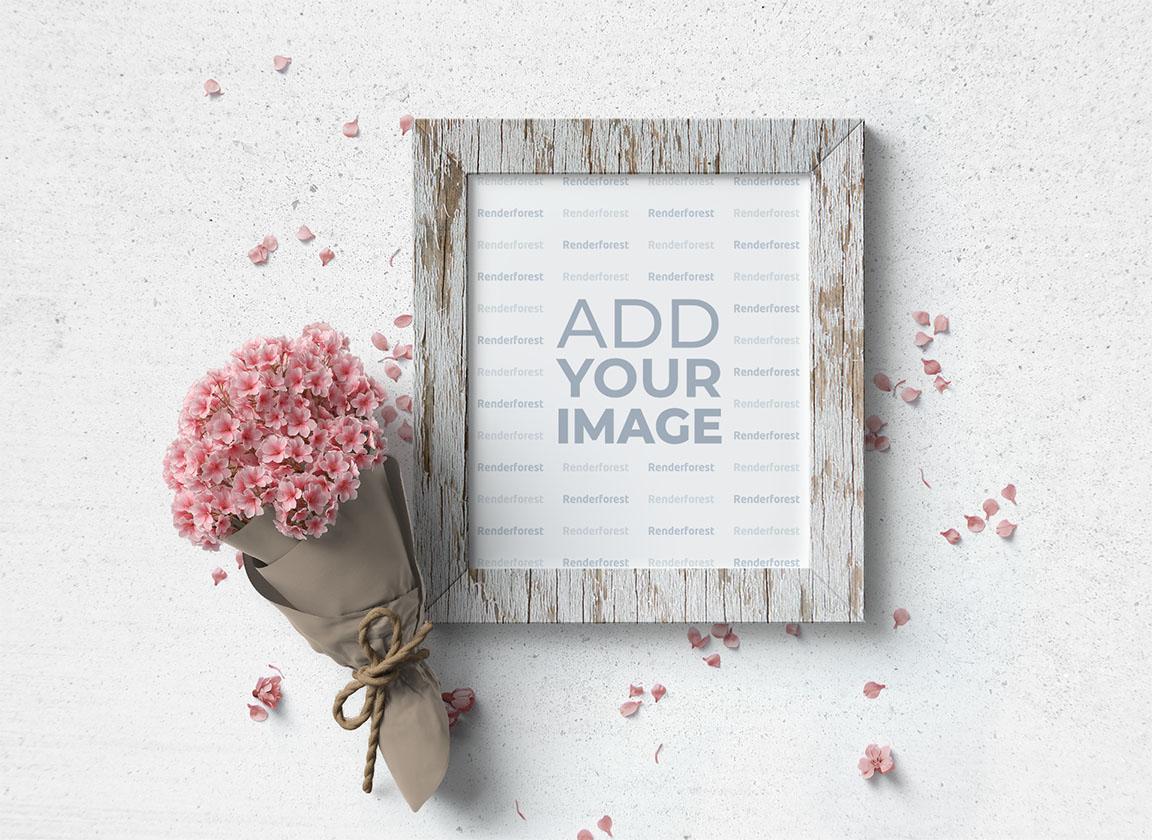 Cadre en bois avec un bouquet de fleurs