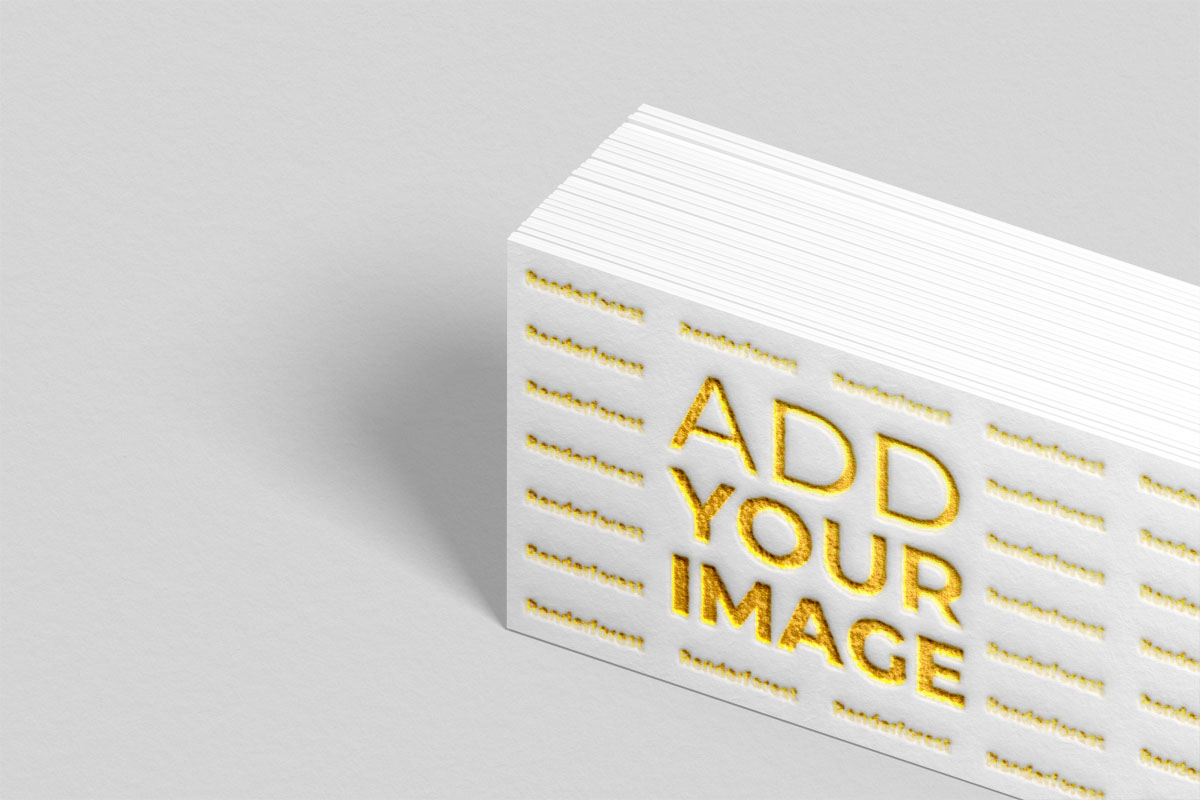Logo sobre pila de tarjetas de presentación