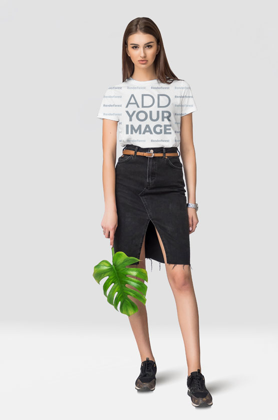 Girl Standing With Monstera Leaf