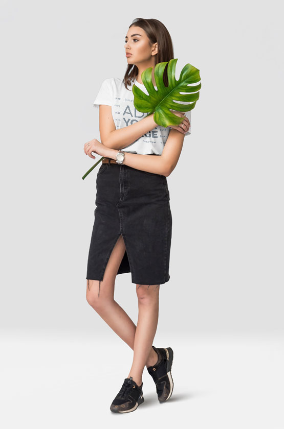 Girl Posing with a Monstera Leaf