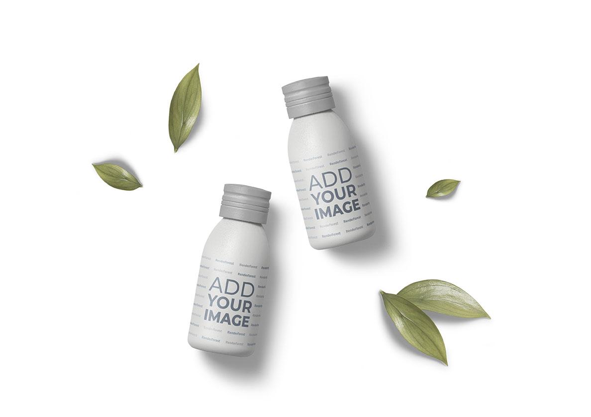 Essenzflaschen und kleine Blätter