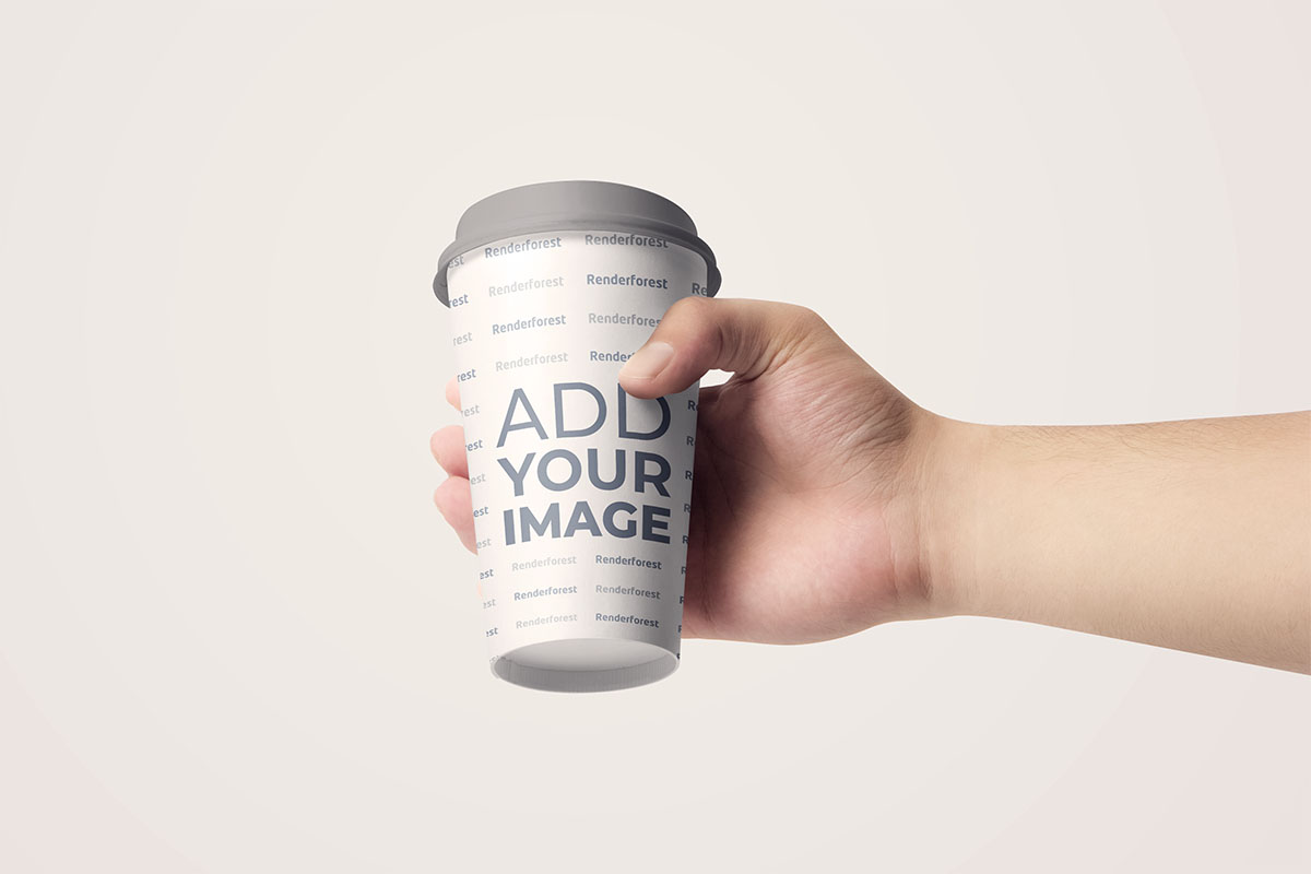 Hand Holding a Paper Coffee Cup