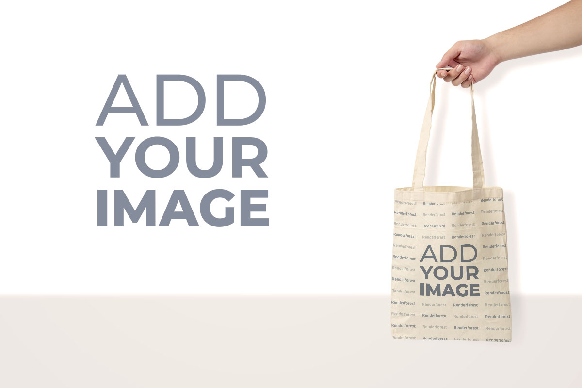 Hand Holding a Tote Bag with a Brand Logo