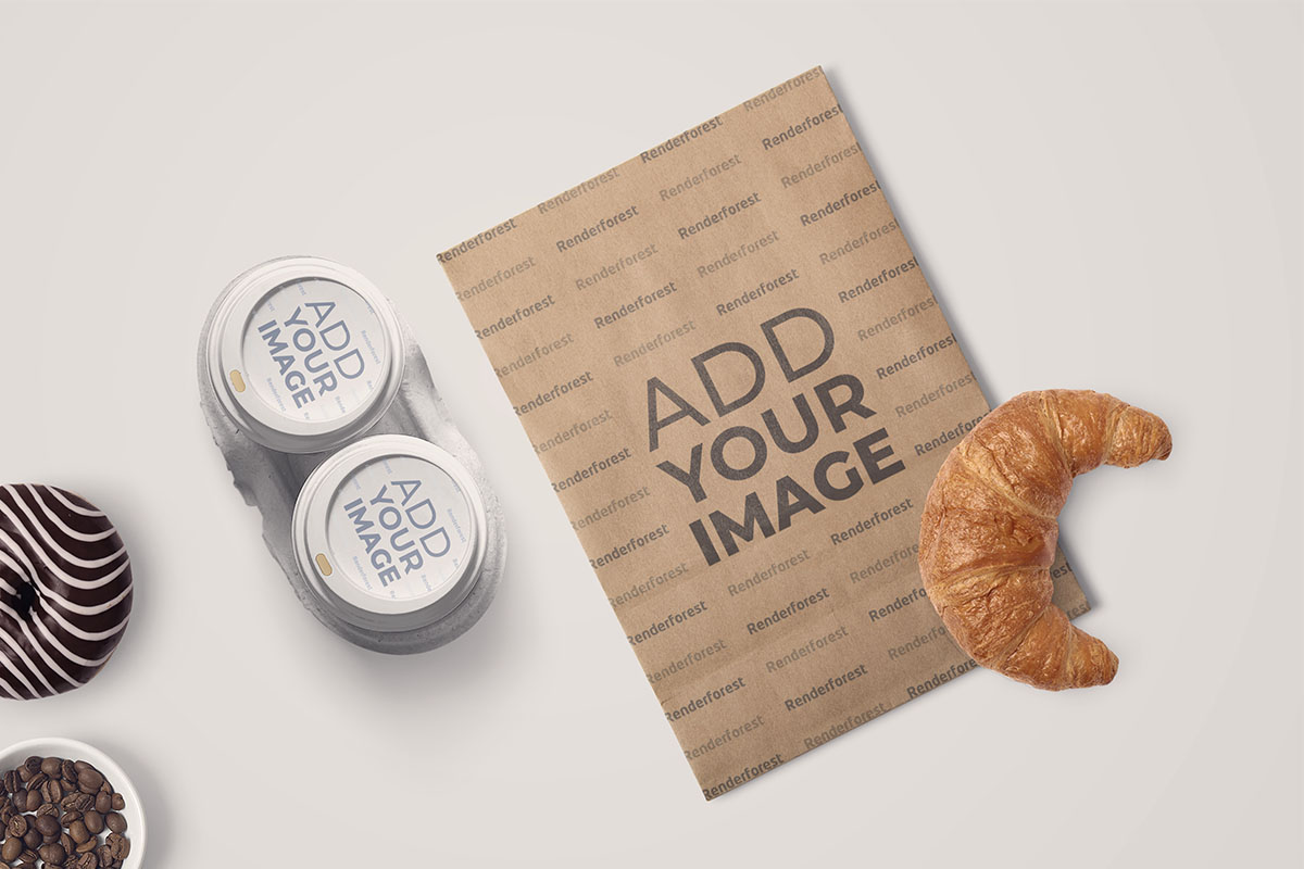 Paper Coffee Cups and a Flyer with a Croissant