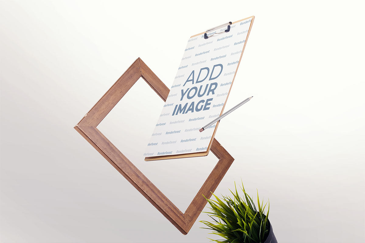 Clipboard and a Wooden Frame in the Air