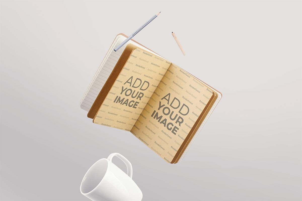 Aufgeschlagener Notizblock, Stifte und ein Becher in der Luft