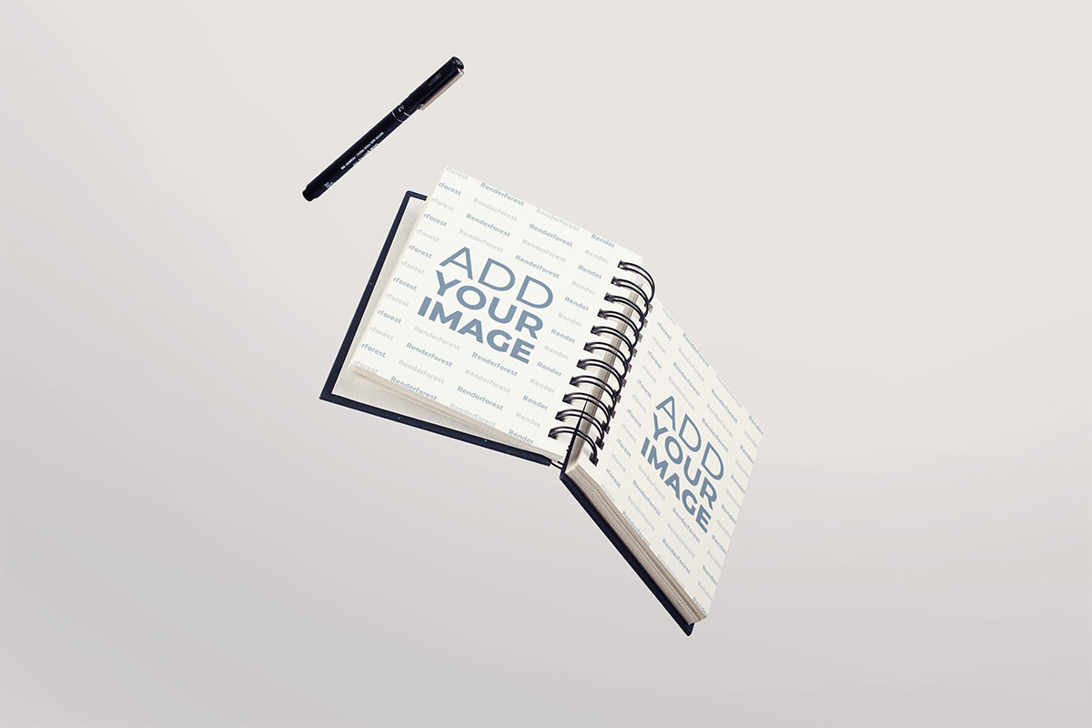 Aufgeschlagenes Hardcover-Skizzenbuch mit einem Stift in der Luft